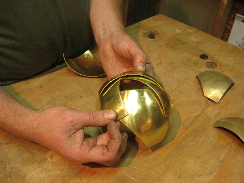 brass sphere experiment