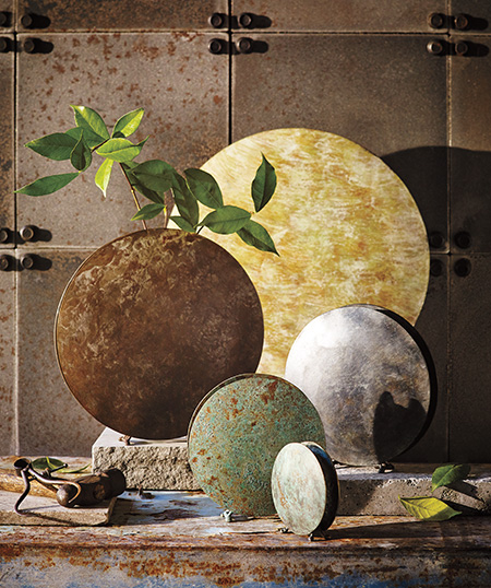 Handmade round vases in patinaed brass